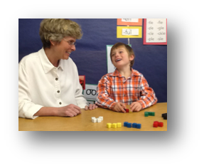 Maria Bagby working with a child at Therapeutic Learning Center